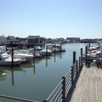 Photo taken at Lighthouse Pointe Waterfront Restaurant & Bar by Lauren K. on 6/21/2013