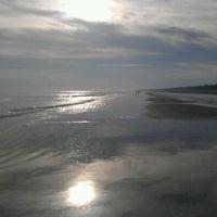 Photo taken at Coligny Beach by Derek B. on 2/15/2014