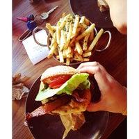 Photo taken at Roam Artisan Burgers by Bettina P. on 3/28/2013