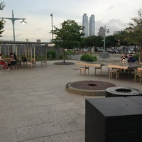 Photo taken at Two Too Large Tables - Hudson River Park by Paul B. on 6/30/2013