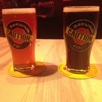 Photo taken at CAUTION: Brewing Company by Lindsay M. on 1/1/2014