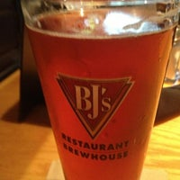 Photo taken at BJ's Restaurant and Brewhouse by Dennis B. on 5/23/2013