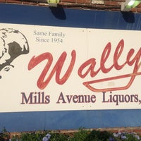 Photo taken at Wally's Mills Avenue Liquors by Paul B. on 7/3/2016