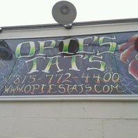Photo taken at Opies Tats by Cory C. on 10/25/2012