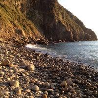 Photo taken at Spiaggia di Riomaggiore by Stefano R. on 12/31/2012