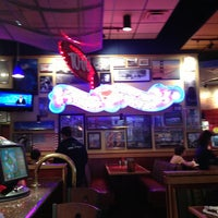 Photo taken at Red Robin Gourmet Burgers by Scary S. on 12/23/2012