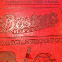 Photo taken at Boston's Restaurant & Sports Bar by Optimal A. on 11/30/2012