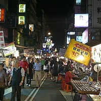 Photo taken at Miaokou Night Market by Celline T. on 10/25/2012