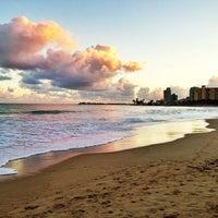 Photo taken at Isla Verde Beach - Balneario Isla Verde (La Playa) by Raul C. on 12/27/2012