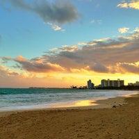 Photo taken at Isla Verde Beach - Balneario Isla Verde (La Playa) by Raul C. on 1/10/2013