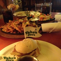 Photo taken at Tahoe Joe's Famous Steakhouse by Andrew B. on 11/13/2012