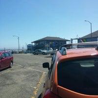 Photo taken at Breakwater Cove Marina by kumi m. on 3/26/2016