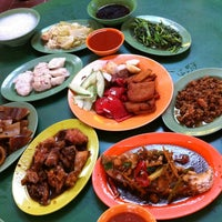 Photo taken at Teochew Rice & Porridge by Sally Y. on 12/24/2012