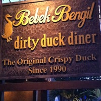 Photo taken at Bebek Bengil (Dirty Duck Diner) by Sally Y. on 12/15/2012