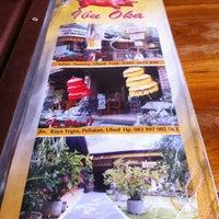 Photo taken at Babi Guling Ibu Oka by Sally Y. on 12/16/2012