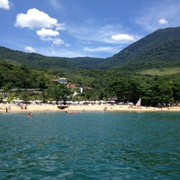 Photo taken at Praia do Curral by Andréa A. on 1/25/2013