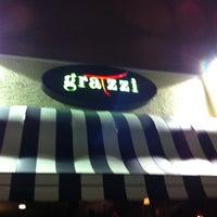 Photo taken at Gratzzi Italian Grille by Daniel F. on 12/19/2012