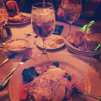 Photo taken at Bellini's Italian Cafe and Pizza by Jordan M. on 10/26/2014