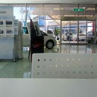 Photo taken at ネッツトヨタ北九州 本店 by Ryoichi S. on 9/26/2013