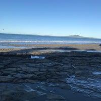Photo taken at Mairangi Bay Beach by Michelle C. on 5/13/2017