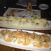 Photo taken at Kumi Japanese Restaurant + Bar by Leah on 10/15/2013