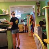 Photo taken at OC Surf Cafe by Patricia M. on 9/21/2013
