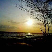 Photo taken at Pantai Kuwaru by Septiani K. on 1/9/2015