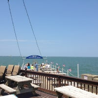 Photo taken at Sunset Harbor Bar & Grille by Craig U. on 6/23/2013