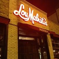 Photo taken at Lou Malnati's Pizzeria by Jennifer S. on 11/1/2012