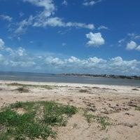Photo taken at praia do caúra by Vinícius B. on 7/4/2013