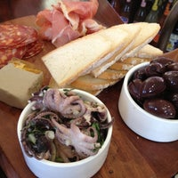 Photo taken at Quattro Formaggi Deli by Cassie B. on 10/1/2012