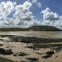 Photo taken at Daymer Bay by Olly S. on 5/20/2015