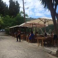 Photo taken at Taverna Kouloura by Olly S. on 7/14/2014