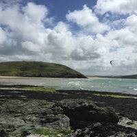 Photo taken at Daymer Bay by Olly S. on 5/18/2015