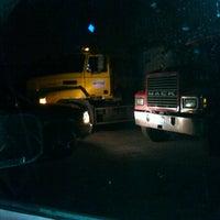 Photo taken at Tramell trucking yard by Michael J. W. on 12/14/2012