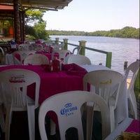 Photo taken at Restaurante Puerto Ceiba by Angel N. on 6/7/2013