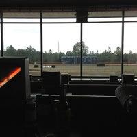 Photo taken at Pensacola Greyhound Track by Kyle M. on 12/29/2012