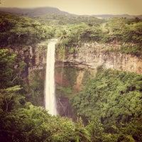 Photo taken at Chamarel Waterfall by Yuri E. on 4/16/2013