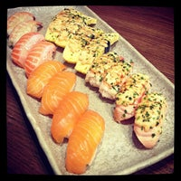 Photo taken at Sushi Zanmai by Kim K. on 6/19/2013