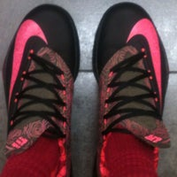 Photo taken at Champs Sports by a a. on 10/7/2013