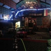 Photo taken at Sphinx Hookah Bar & Cafe by Megg B. on 12/16/2012