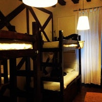 Photo taken at Travelers House Hostel by Elliot W. on 4/2/2013