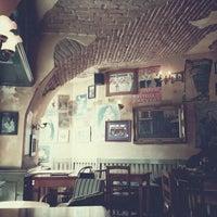 Photo taken at Le Petit Café by Matthias A. on 5/19/2013