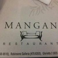 Photo taken at Mangan by Jet A. on 4/27/2016