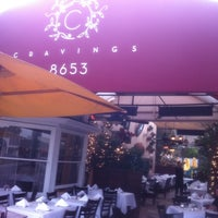 Photo taken at Cravings by ROSSİ BARBAROSSA ASMALİMESCİT T. on 10/12/2012