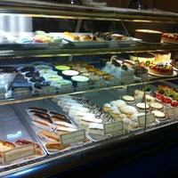 Photo taken at La Tropezienne Bakery by Andrea A. on 7/18/2013