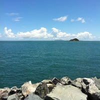 Photo taken at Mackay Harbour by Michelle C. on 1/11/2013