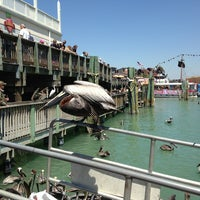 Photo taken at John's Pass Village and Boardwalk by Katie H. on 3/28/2013