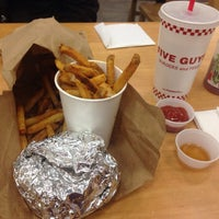 Photo taken at Five Guys by Goldie☠ T. on 3/26/2014