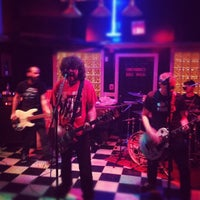 Photo taken at News Cafe by Jon K. on 11/24/2012